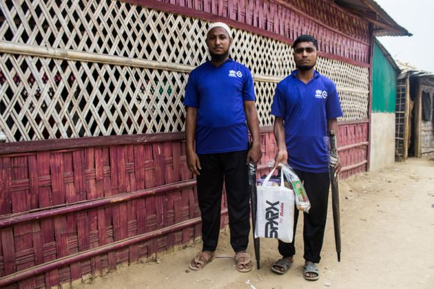 Elephant response team volunteers Jahid Hossain (left) and Mohammed Yahea (right) with equipment given...
