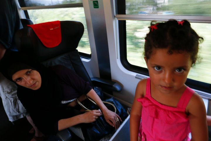 A woman with her daughter aboard a train from Budapest to Vienna on Aug. 31, 2015.