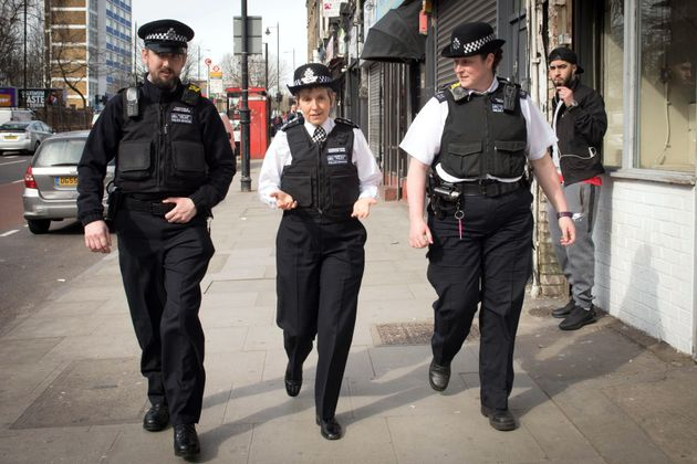 Metropolitan Police Commissioner Cressida Dick (centre) walks with officers through Stoke Newington in north London, after a recent spate of gang violence in which several teenagers died.