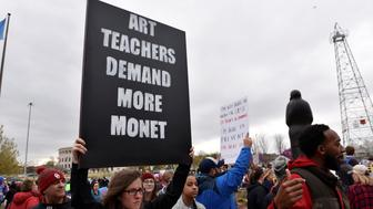 Teachers rally outside the state Capitol for the second day of a teacher walkout to demand higher pay and more funding for education in Oklahoma City, Oklahoma, U.S., April 3, 2018.  REUTERS/Nick Oxford