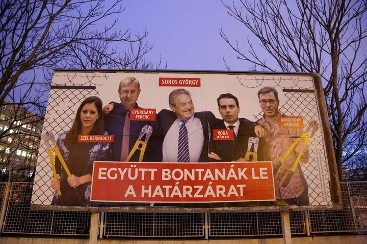 A Fidesz party billboard depicts Hungarian-American George Soros and members of the opposition holding wire cutters arou