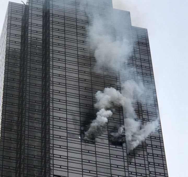 Smoke rises from the 50th floor of Trump Tower in New York on April 7, 2018.