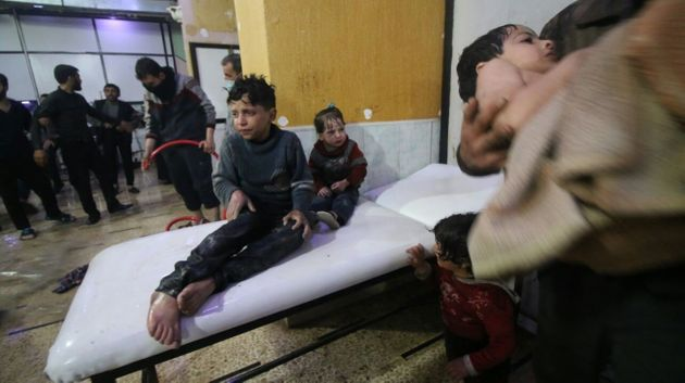 Affected Syrian kids wait to receive medical treatment after Assad regime forces allegedly conducted...