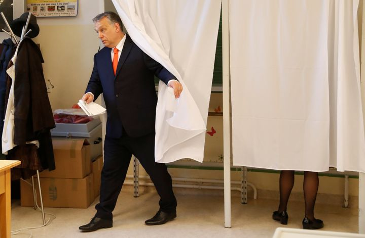 Hungarian Prime Minister Viktor Orbán leaves a polling booth.