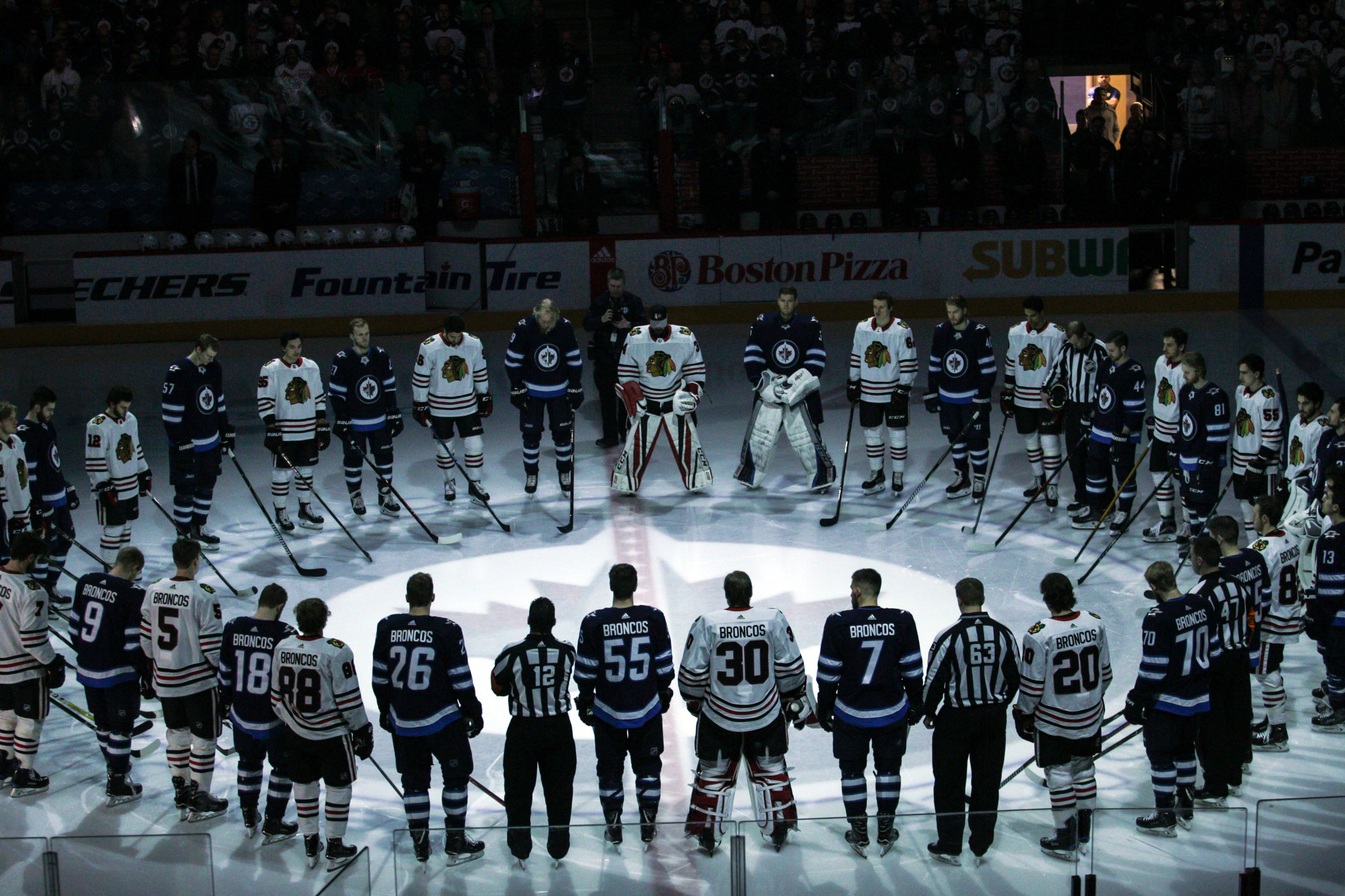 Apr 7, 2018; Winnipeg, Manitoba, CAN; The Winnipeg Jets and Chicago Blackhawks observe a minute of silence for the Humbolt Broncos before the first period at Bell MTS Place. Mandatory Credit: Terrence Lee-USA TODAY Sports