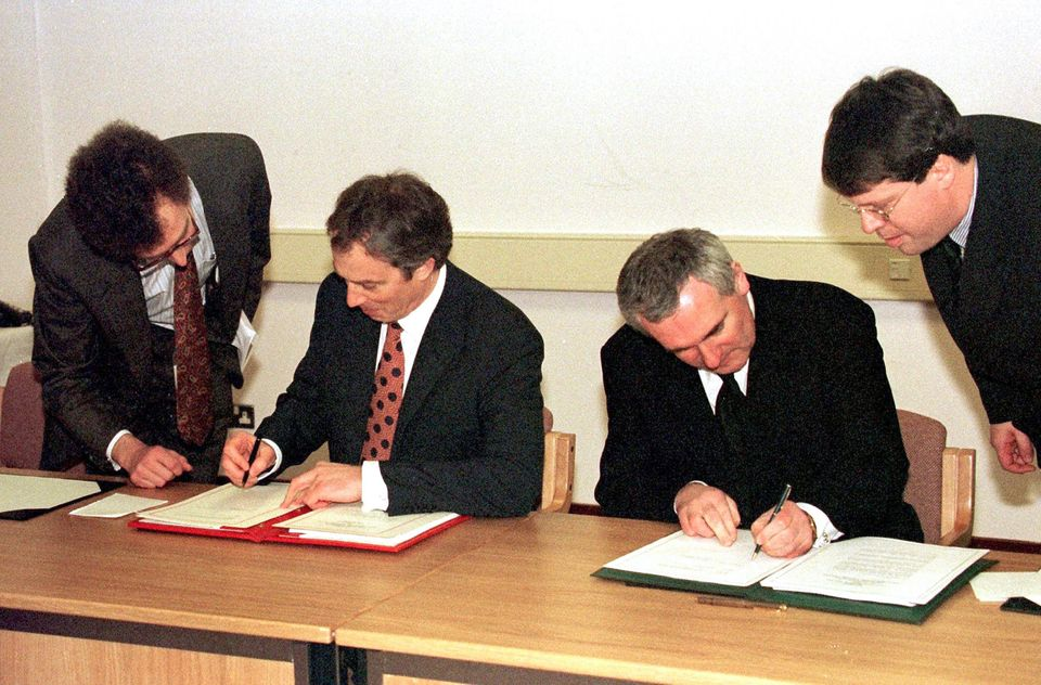Former British Prime Minister Tony Blair (left) and Irish Taoiseach Bertie Ahern signing the Good Friday...