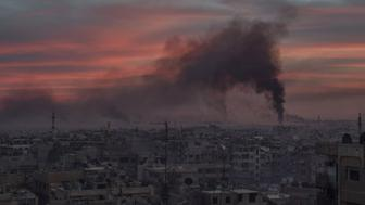 DAMASCUS, SYRIA - APRIL 07: Smoke rises after Assad Regime carried out an airstrike at Duma town of Eastern Ghouta in Damascus, Syria on April 07, 2018. (Photo by Mouneb Taim/Anadolu Agency/Getty Images)