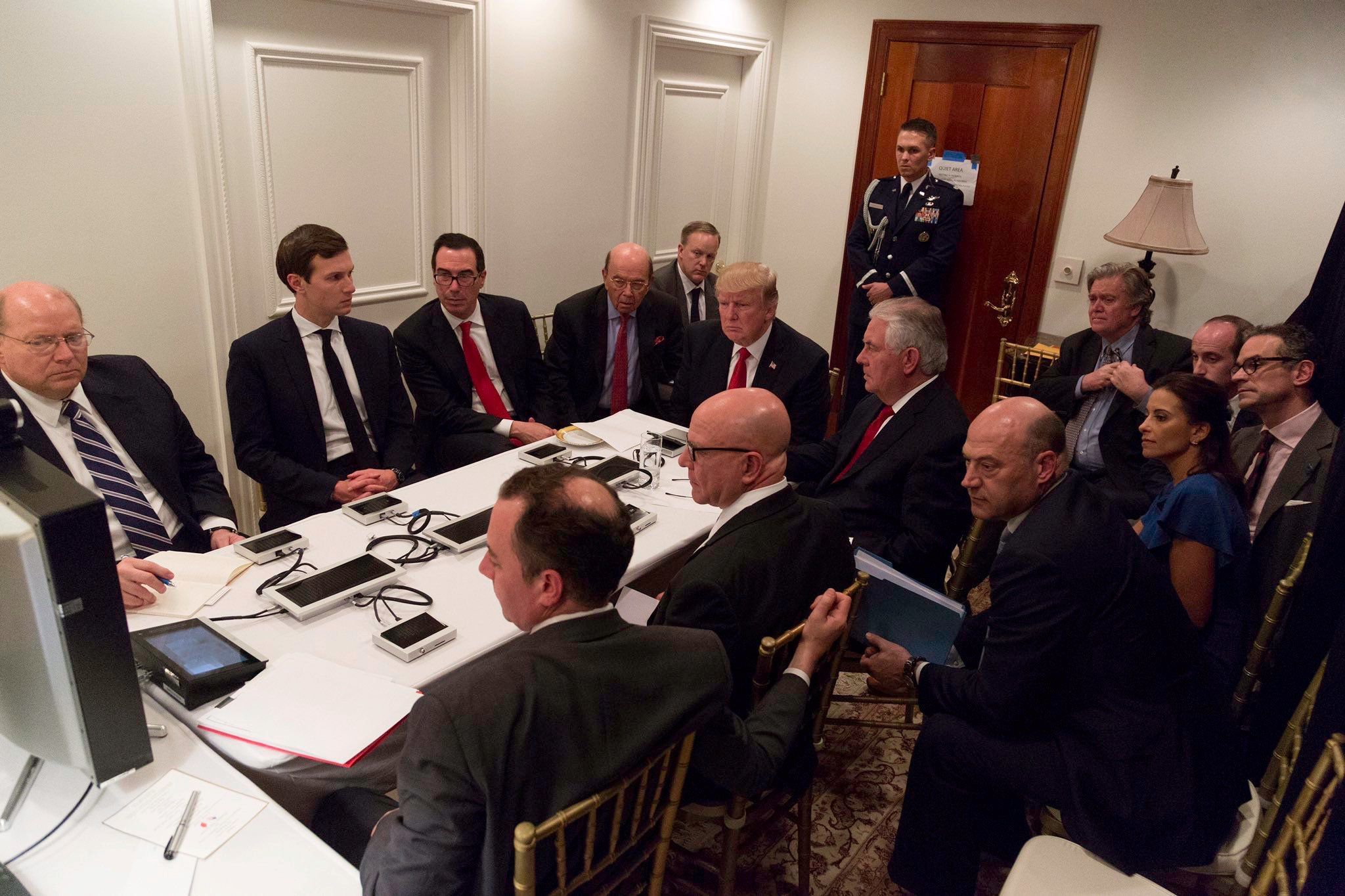U.S. President Donald Trump is shown in an official White House handout image meeting with his National  Security team and being briefed by Chairman of the Joint Chiefs of Staff General Joseph Dunford via secure video teleconference after a missile strike on Syria while inside the Sensitive Compartmented Information Facility at his Mar-a-Lago resort in West Palm Beach, Florida, U.S. April 6, 2017. White House Press Secretary Sean Spicer stated that this image has been digitally edited for security purposes when he released the photo via Twitter on April 7, 2017. Pictures clockwise from top L: Deputy Chief of Staff Joe Hagin, Senior Advisor Jared Kushner, Treasury Secretary Steven Mnuchin, Commerce Secretary Wilbur Ross, White House Press Secretary Sean Spicer, President Trump, Secretary of State Rex Tillerson, Senior advisor Steve Bannon, Senior advisor Stephen Miller,  national security aide Michael Anton, Deputy National Security Advisor for Strategy Dina Powell, National Economic Council Director Gary Cohn, National security adviser Lt. Gen. H.R. McMaster and Chief of Staff Reince Priebus.    The White House/Handout via REUTERS ATTENTION EDITORS - THIS IMAGE WAS PROVIDED BY A THIRD PARTY. EDITORIAL USE ONLY.  IT IS DISTRIBUTED, EXACTLY AS RECEIVED BY REUTERS, AS A SERVICE TO CLIENTS. NOT FOR SALE FOR MARKETING OR ADVERTISING CAMPAIGNS     TPX IMAGES OF THE DAY
