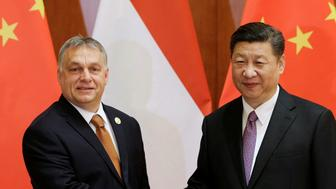 Chinese President Xi Jinping meets Hungarian Prime Minister Viktor Orban ahead of the Belt and Road Forum in Beijing, China May 13, 2017. REUTERS/Jason Lee