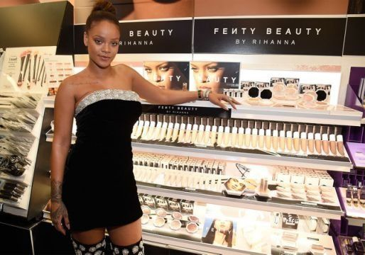 Rihanna with a display of her namesake makeup line, Fenty Beauty.