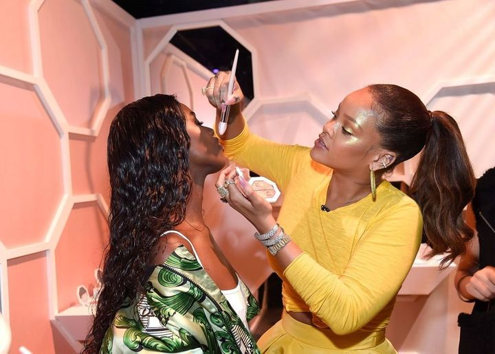 During Fenty Beauty's launch in Brooklyn, N.Y., Rihanna showed off her highlighting skills on model Leomie Anderson.&nb