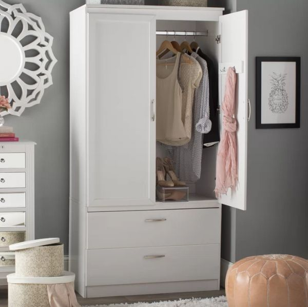 If you're willing to spend a little more money on a no-closet situation, get a wardrobe. They're sleek, hide the mess, and ta