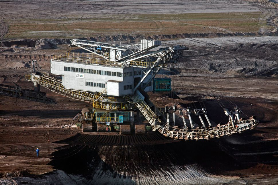 Brown coal/lignite being extracted by huge bucket-wheel excavators at open-pit mine, Saxony-Anhalt, Germany on March 24, 2012