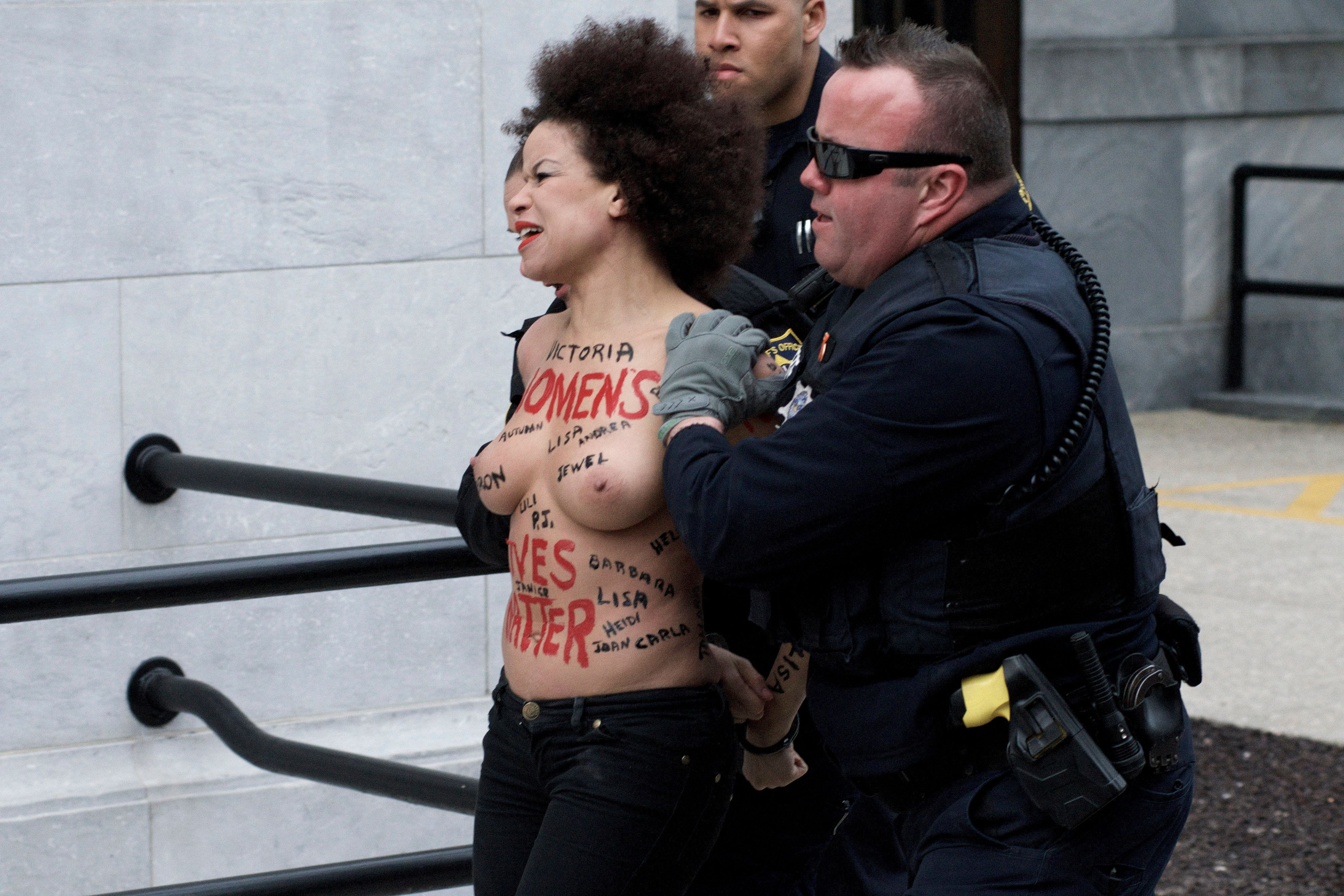 (EDITORS NOTE: Image contains nudity and graphic content.) A Protestor disturb the scene as Bill Cosby returns to Montgomery County Courthouse, in Norristown, PA on April 9, 2018 ahead of the sexual assault retail against the 80 year old actor and comedian. (Photo by Bastiaan Slabbers/NurPhoto via Getty Images)