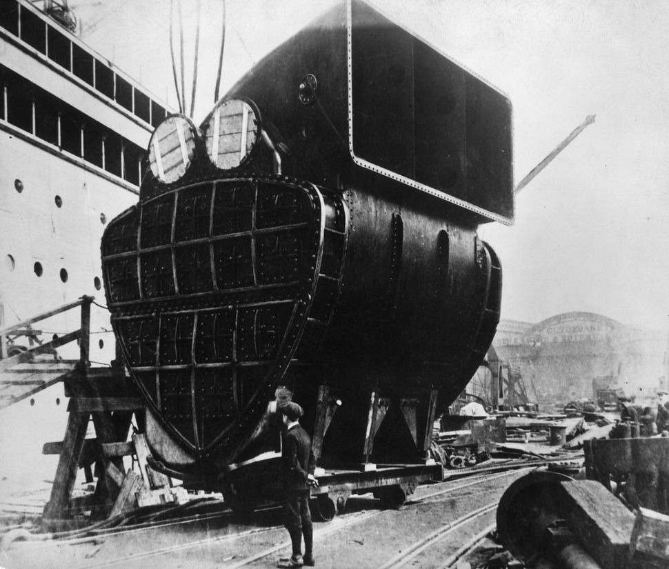 A giant condenser is hoisted up to its position on board the Cunard liner Aquitania during its construction at the John Brown
