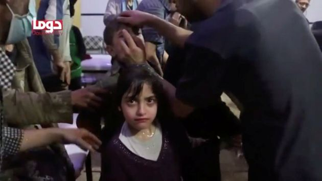 A girl looks on following alleged chemical weapons attack, in what is said to be Douma,