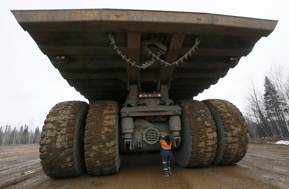 A crew member operating a BelAZ 75710 truck of the Chernigovets coal company, outside the town of Beryozovsky, Kemerovo regio