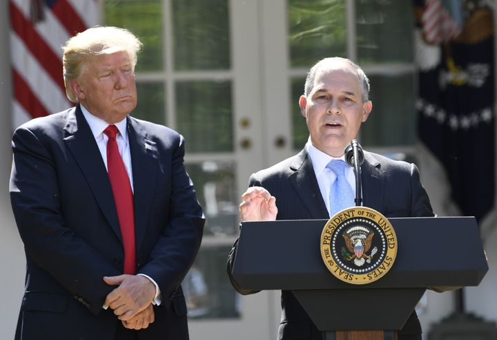 President Donald Trump looks on as Environmental Protection Agency Administrator Scott Pruitt speaks after announcing the U.S