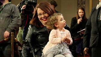Senator Tammy Duckworth (D-IL) carries her daughter Abigail during a mock swearing in with U.S. Vice President Joe Biden during the opening day of the 115th Congress on Capitol Hill in Washington, U.S., January 3, 2017.      REUTERS/Joshua Roberts - RC132AFEF650