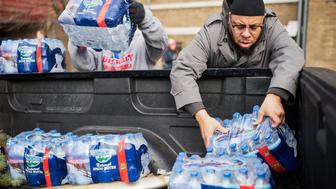 UNITED STATES - FEBRUARY 22: Volunteers load bottled water in a truck at the the Sylvester Broome Center in Flint, Mich., February 22, 2016. The center is being used for water distribution and health care services. The water supply was not properly treated after being switched from Lake Huron to the Flint River and now contains lead and iron. (Photo By Tom Williams/CQ Roll Call)