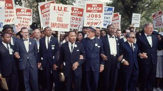 View of some of the leaders of March on Washington for Jobs & Freedom as they march with signs, Washington DC, August 28, 1963. Among those pictured are, front row from left, John Lewis, Matthew Ahman, Floyd B. McKissick (1922 - 1991), Dr. Martin Luther King Jr (1929 - 1968), Reverend Eugene Carson Blake (1906 - 1985), Cleveland Robinson (1914 - 1995), and Rabbi Joachim Prinz (1902 - 1988) (in sunglasses). The march provided the setting for Dr. King's iconic 'I Have a Dream' speech. (Photo by Robert W. Kelley/The LIFE Picture Collection/Getty Images)