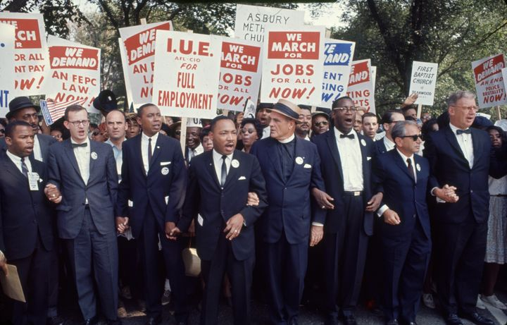 Dr. Martin Luther King Jr. and other prominent civil rights and religious leaderswalk during the March on Washington fo