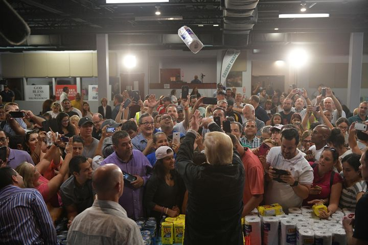 President Donald Trump throws a paper towel roll as he visits the Cavalry Chapel in Guaynabo, Puerto Rico, on Oct. 3, 2017.
