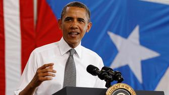 U.S. President Barack Obama speaks at a welcoming event after arriving at Luis Munoz Marin International Airport in Puerto Rico, June 14, 2011.  REUTERS/Larry Downing (PUERTO RICO - Tags: POLITICS)