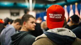 Trump supporter wears a hat saying make america great again wait for the arrival of Republican presidential candidate Donald Trump during his campaign event at the University of Iowa on January 26, 2016 in Iowa City, Iowa. Trump continues his quest to become the Republican presidential nominee. (Photo by Jim Vondruska/NurPhoto) (Photo by NurPhoto/NurPhoto via Getty Images)