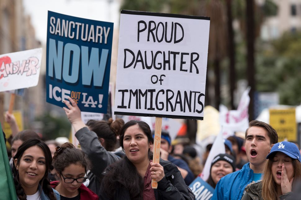 Protesters at a pro-immigration rally in Los Angeles, on Feb. 18, 2017. Organizers called for a stop to ICE raids and deporta