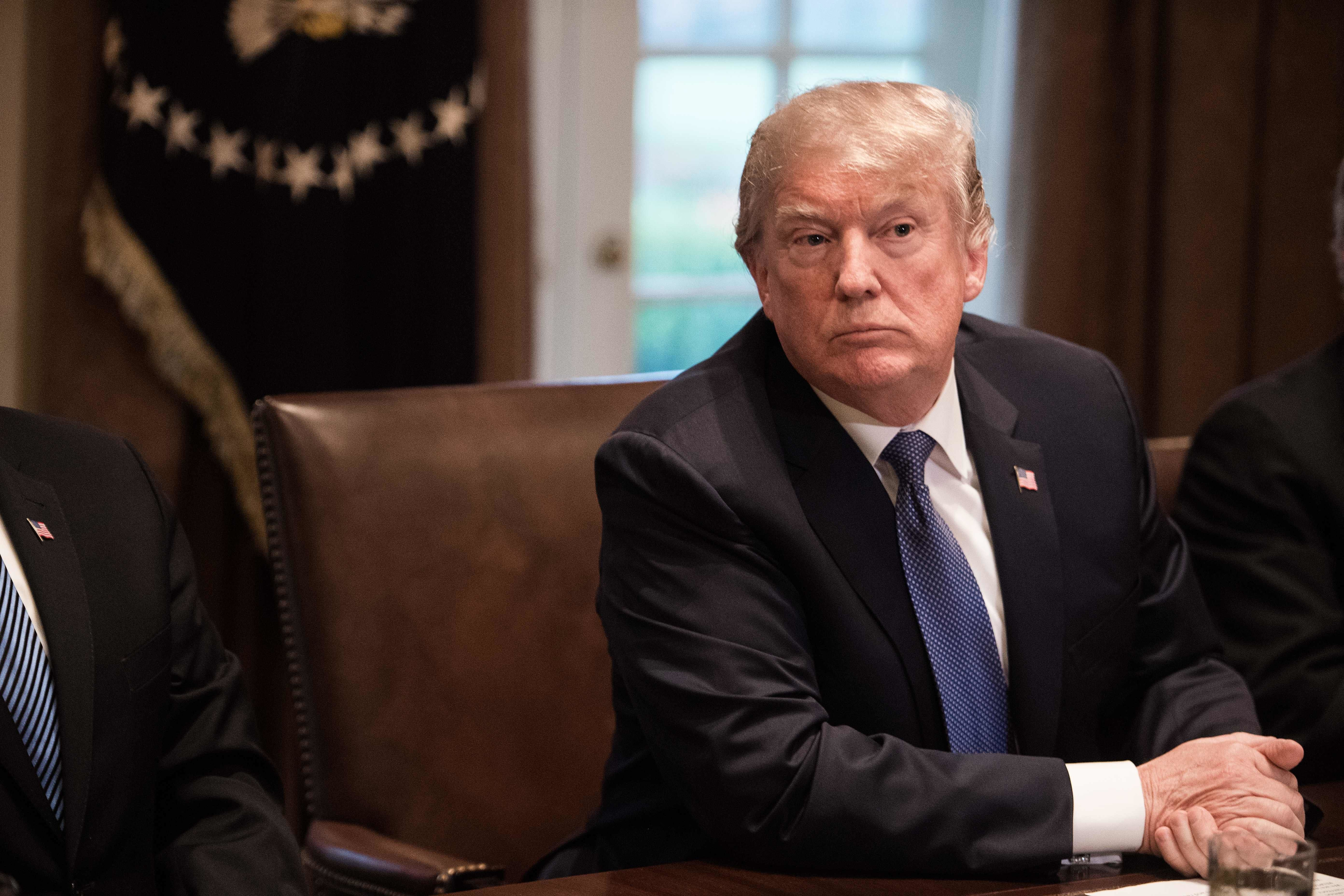 US President Donald Trump attends a meeting with senior military leaders at the White House in Washington, DC, on April 9, 2018. President Donald Trump said Monday that 'major decisions' would be made on a Syria response in the next day or two, after warning that Damascus would have a 'big price to pay' over an alleged chemical attack on a rebel-held town.Trump condemned what he called a 'heinous attack on innocent' Syrians in Douma, as he opened a cabinet meeting at the White House.   / AFP PHOTO / NICHOLAS KAMM        (Photo credit should read NICHOLAS KAMM/AFP/Getty Images)
