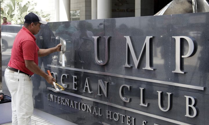 A worker removed the Trump name from a hotel in Panama City.