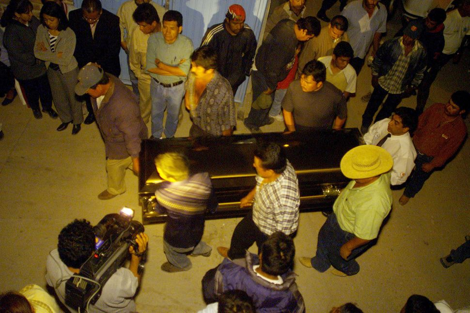 Relatives and neighbors carry the casket of a migrant who died in a truck in Victoria, Texas, on May 14, 2003.