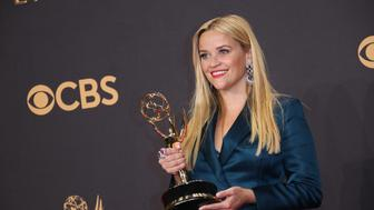 LOS ANGELES, CA - SEPTEMBER 17: Reese Witherspoon poses in the press room with her Emmy award for Outstanding Limited Series for 'Big Little Lies' at the 69th Annual Primetime Emmy Awards at Microsoft Theater on September 17, 2017 in Los Angeles, California. (Photo by Dan MacMedan/Getty Images)