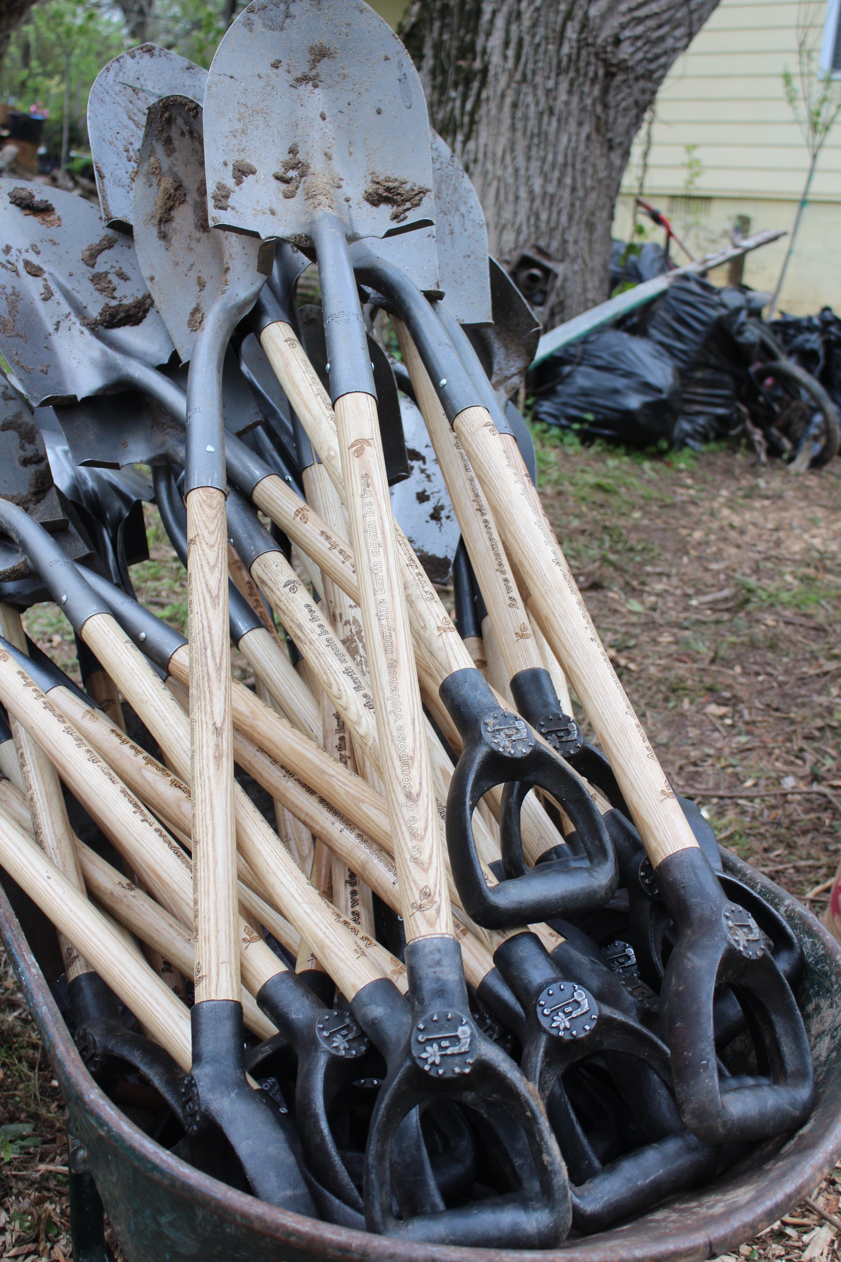 Lead to Life's shovels during a garden action day in Atlanta over the weekend. The tools feature inscriptions promoting nonviolence and handles made from an iron alloy that includes metal from melted guns.