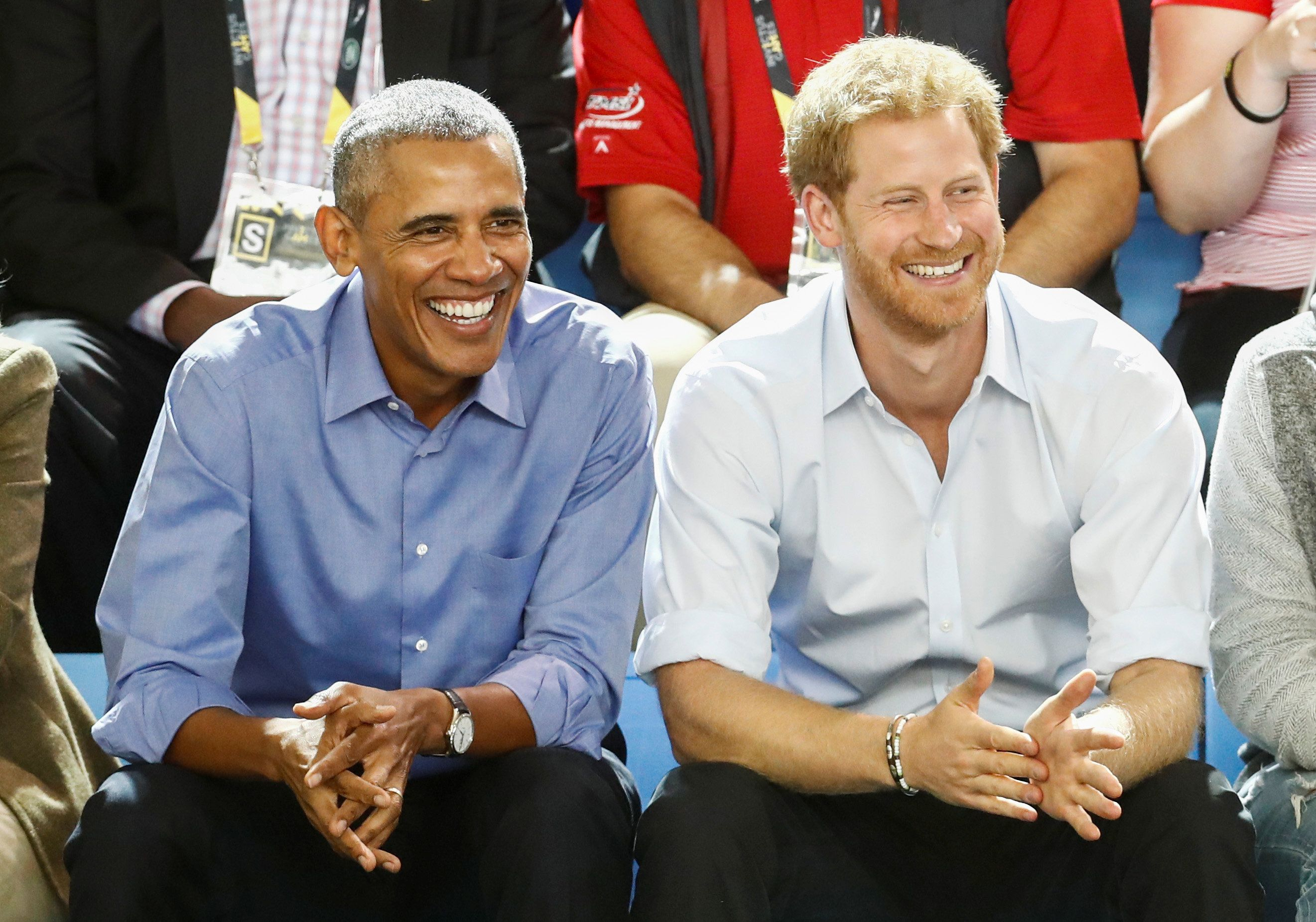 Britain's Prince Harry (R) and former U.S. President Barack Obama watch a wheelchair basketball event during the Invictus Games in Toronto, Ontario, Canada September 29, 2017.    REUTERS/Mark Blinch
