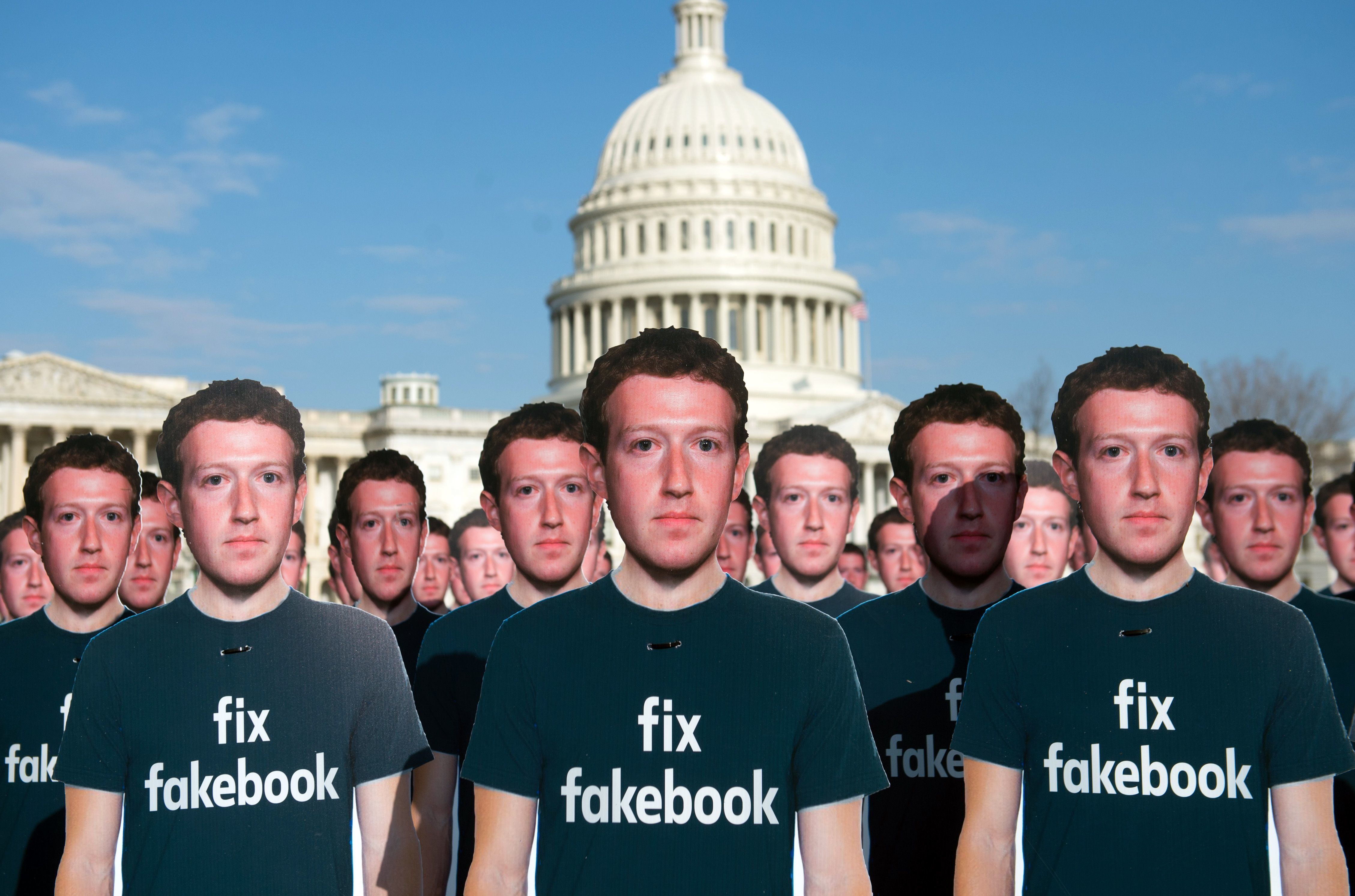 One hundred cardboard cutouts of Facebook founder and CEO Mark Zuckerberg stand outside the U.S. Capitol.