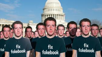 One hundred cardboard cutouts of Facebook founder and CEO Mark Zuckerberg stand outside the US Capitol in Washington, DC, April 10, 2018. Advocacy group Avaaz is calling attention to what the groups says are hundreds of millions of fake accounts still spreading disinformation on Facebook. / AFP PHOTO / SAUL LOEB        (Photo credit should read SAUL LOEB/AFP/Getty Images)