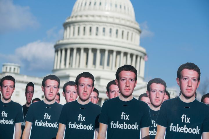 Cutouts of Facebook CEO Mark Zuckerberg appear on the Capitol grounds on Tuesday.