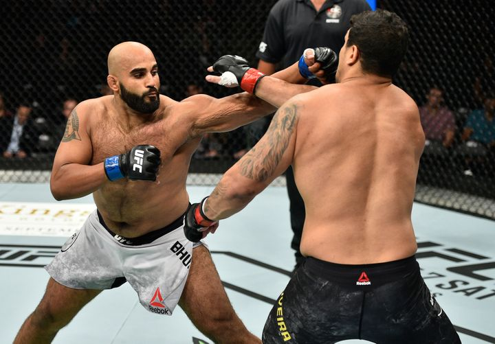 Arjan Singh Bhullar lands a punch against Luis Henrique in a September 2017 match.
