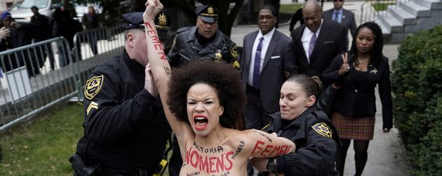 Police hold back protester Nicolle Rochelle in front of the Montgomery County Courthouse in Norristown,...