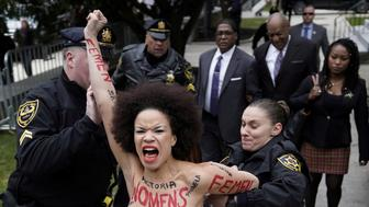 A protester is subdued by the police after breaking through the barriers, as actor and comedian Bill Cosby arrives for the first day of his sexual assault retrial at the Montgomery County Courthouse in Norristown, Pennsylvania, U.S., April 9, 2018.  REUTERS/Jessica Kourkounis  TEMPLATE OUT     TPX IMAGES OF THE DAY