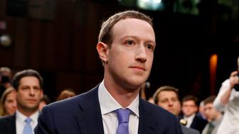 Facebook CEO Mark Zuckerberg listens to opening statements while testifying before a Senate Judiciary and Commerce Committees joint hearing regarding the company's use and protection of user data on Capitol Hill in Washington, U.S., April 10, 2018. REUTERS/Aaron P. Bernstein