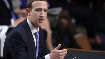 WASHINGTON, DC - APRIL 10:  Facebook co-founder, Chairman and CEO Mark Zuckerberg testifies before a combined Senate Judiciary and Commerce committee hearing in the Hart Senate Office Building on Capitol Hill April 10, 2018 in Washington, DC. Zuckerberg, 33, was called to testify after it was reported that 87 million Facebook users had their personal information harvested by Cambridge Analytica, a British political consulting firm linked to the Trump campaign.  (Photo by Chip Somodevilla/Getty Images)