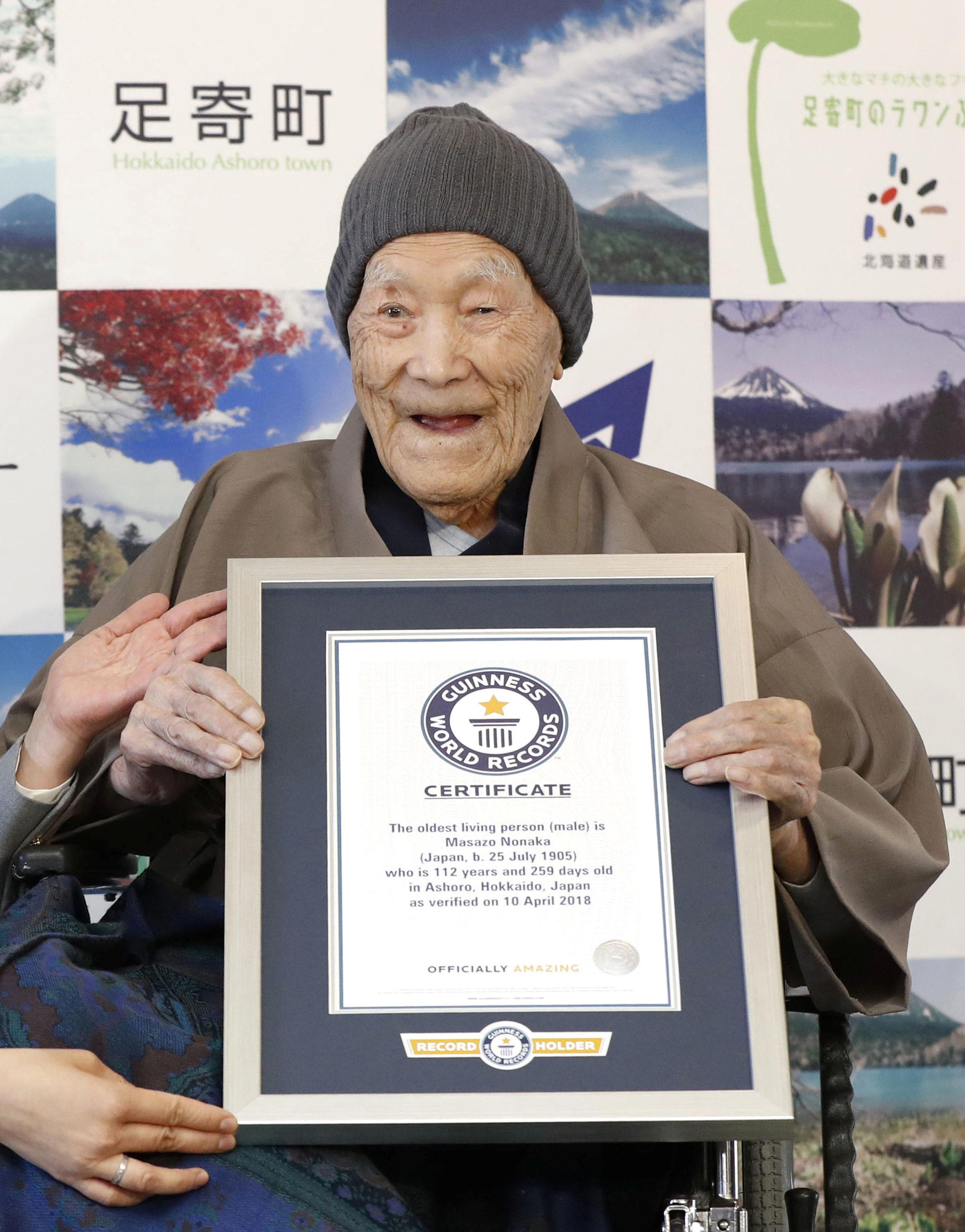 Oldest man enjoys candies, soaking in Japan's hot springs