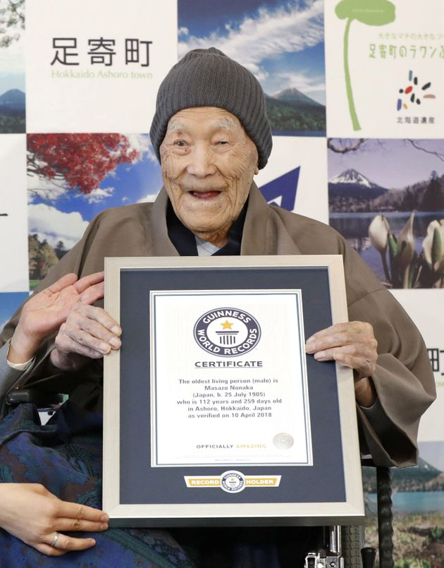 Masazo Nonaka, who was born 112 years and 259 days ago, receives a Guinness World Records certificate...