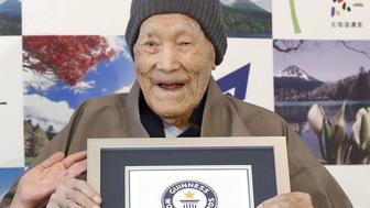 Japanese Masazo Nonaka, who was born 112 years and 259 days ago, receives a Guinness World Records certificate naming him the world's oldest man during a ceremony in Ashoro, on Japan's northern island of Hokkaido, in this photo taken by Kyodo April 10, 2018.  Mandatory credit Kyodo/via REUTERS ATTENTION EDITORS - THIS IMAGE WAS PROVIDED BY A THIRD PARTY. MANDATORY CREDIT. JAPAN OUT. NO COMMERCIAL OR EDITORIAL SALES IN JAPAN.
