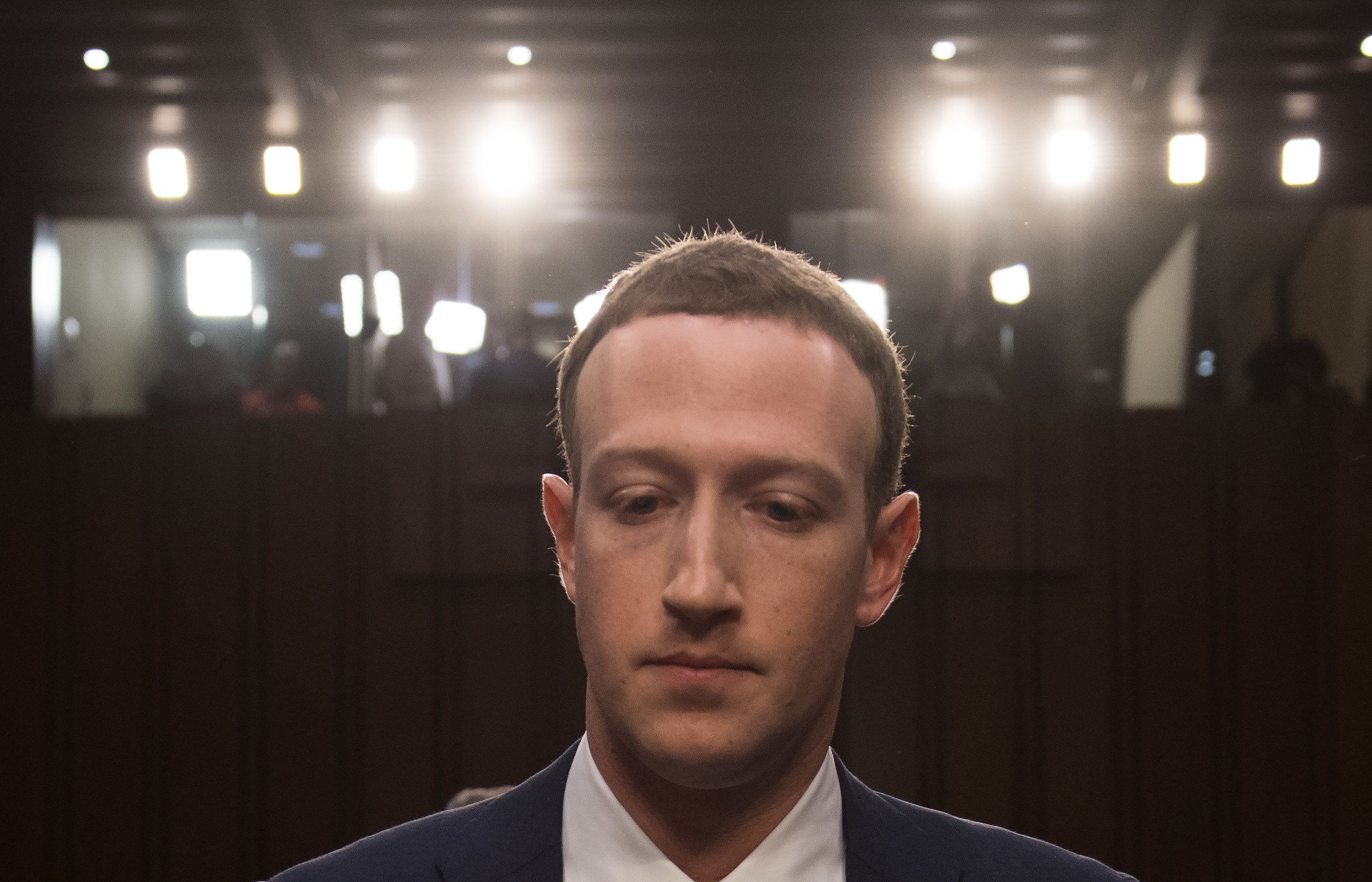 Facebook founder and CEO Mark Zuckerberg arrives to testify following a break during a Senate Commerce, Science and Transportation Committee and Senate Judiciary Committee joint hearing about Facebook on Capitol Hill in Washington, DC, April 10, 2018. / AFP PHOTO / SAUL LOEB        (Photo credit should read SAUL LOEB/AFP/Getty Images)