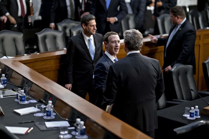 Zuckerberg and Kennedy shake hands and speak to each other following the hearing.