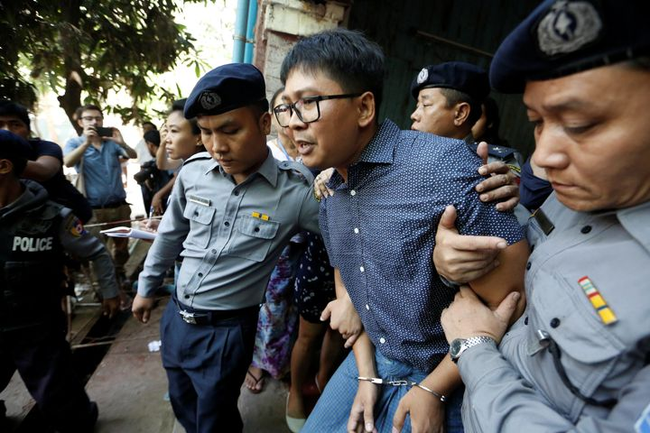 Reuters journalists Wa Lone (above, center) and Kyaw Soe Oo (not shown) are facing a maximum penalty of 14 years in